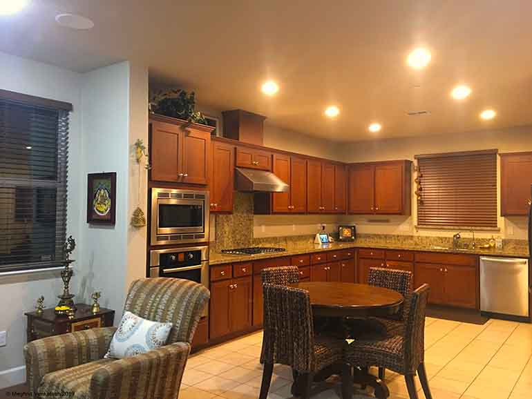 Kitchen with granite countertops and cabinets in  deep amaretto color.
