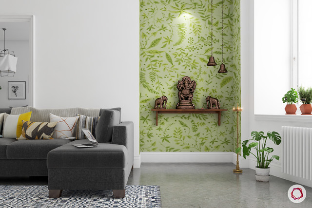 Pooja room design in an apartment with wallpaper in the background. Designed by Livspace.