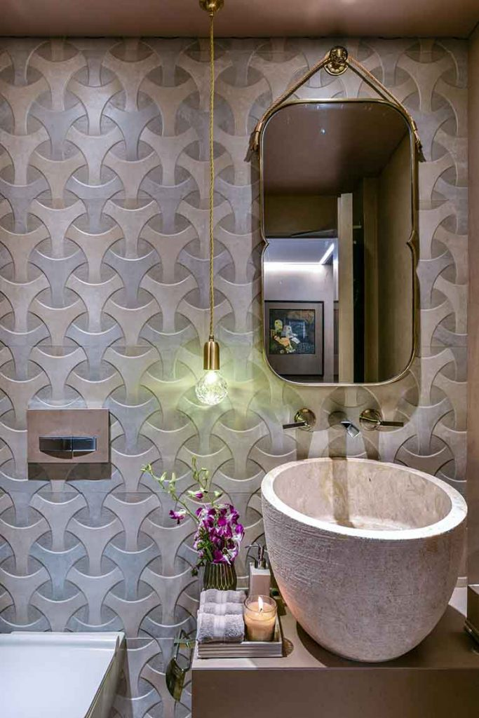 The same color scheme runs in the bathroom as the bedroom.