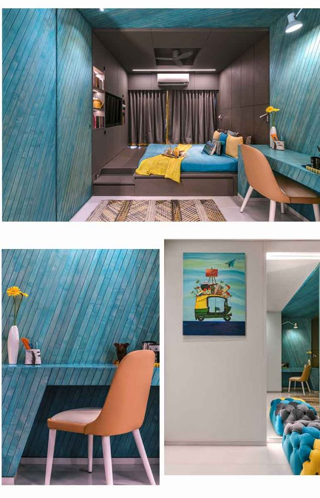 The accent wall of this bedroom is  a turquoise slatted oak-wood angular wrap that stretches from one wall through the ceiling to another. It offers a beautiful contrast against the brown.