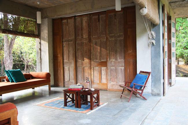 Easy laid back furniture at a rustic sea facing villa in Kihim, Maharashtra