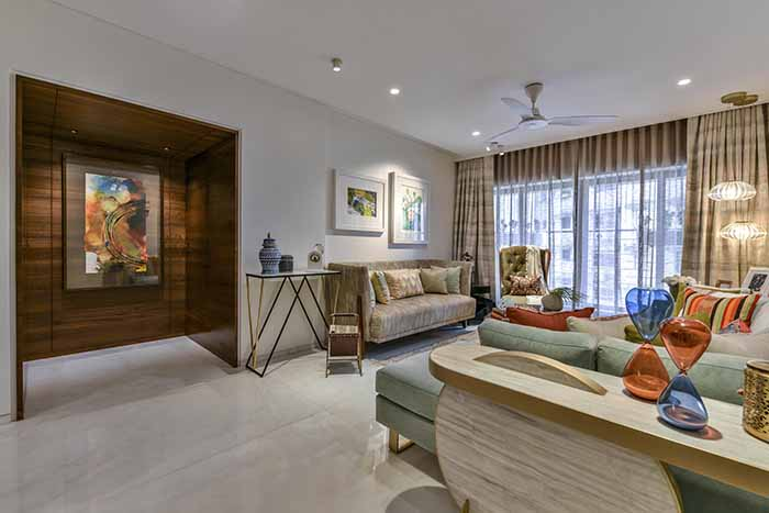 Living room with a custom art installation in the niche.