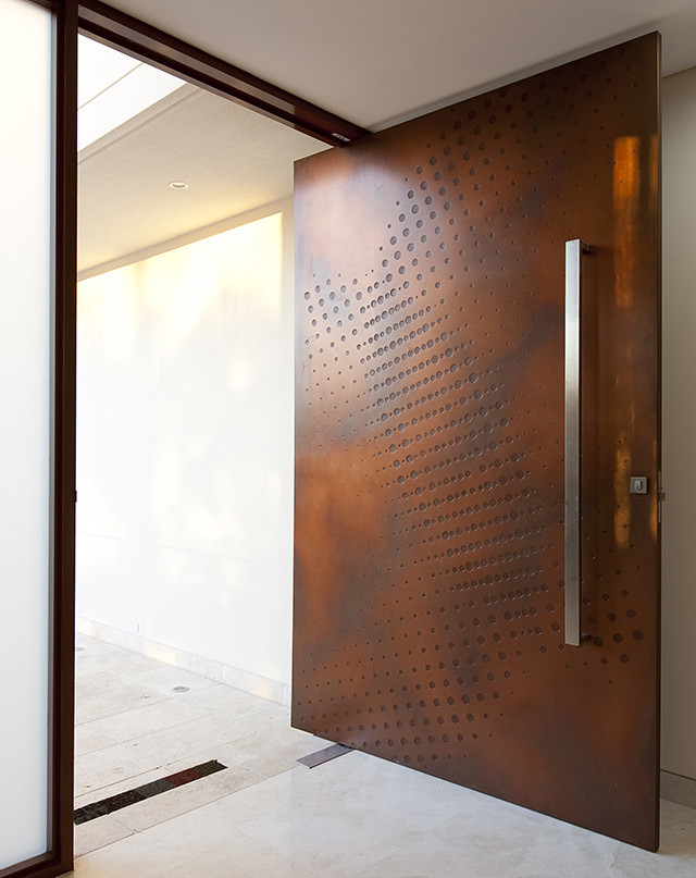 A modern and simple main door design of a home. Very futuristic in look.