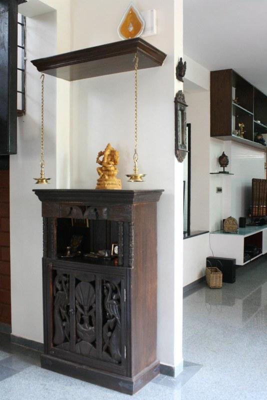 Mandir design in living room with storage