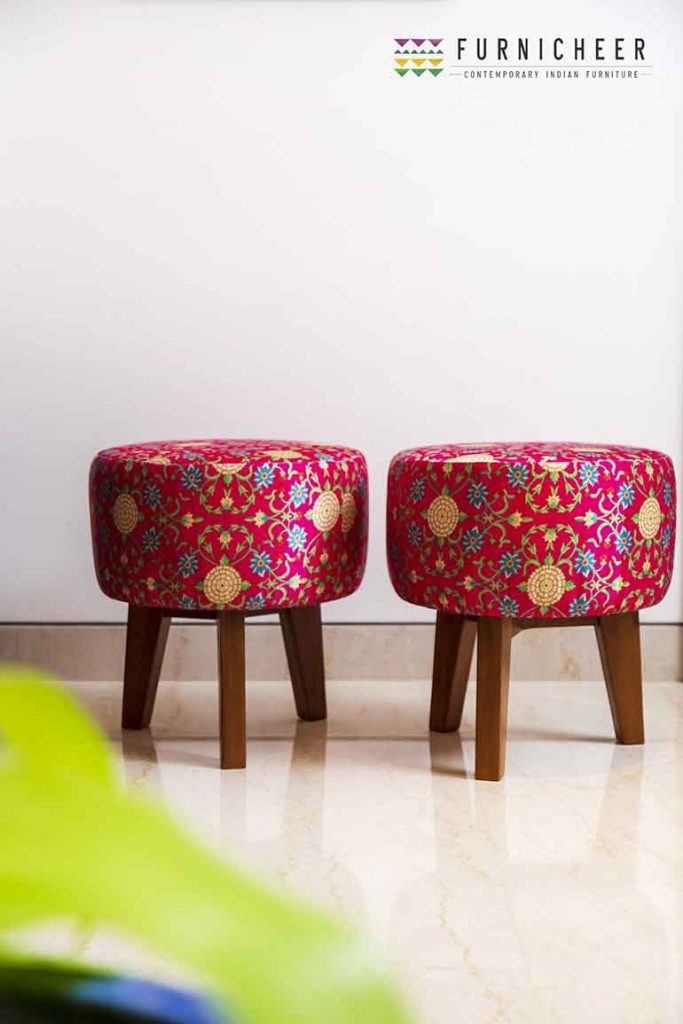 Two pouffes adding additional casual seating to the living room are draped in bagh print.