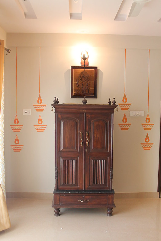 A normal wooden cabinet with lamp decals on either side for that traditional look