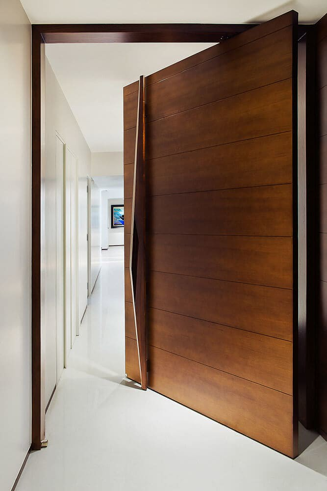 A 9 foot tall pivot main door design that makes for easy movement.
