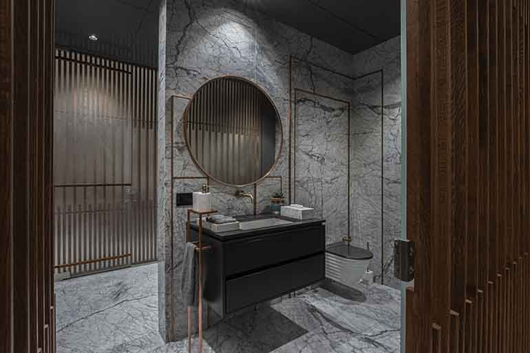 Guest bathroom: copper, oak wood and Statuario Marble takes the luxury quotient off this bathroom a notch higher