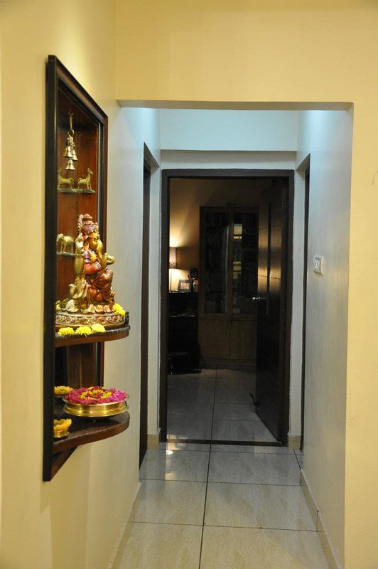 Making room for wall mounted pooja in the passageway outside the bedrooms.